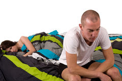 Young worried couple in bed with relation problems Stock Photos