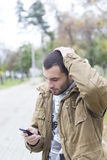 Young worried man looking at his phone Royalty Free Stock Photo