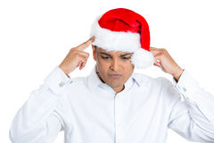 Young worried stressed man in red santa claus hat Royalty Free Stock Photos