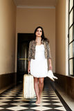 Young worried woman  with an old suitcase Royalty Free Stock Photo