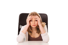 Young worried woman sitting at the desk Royalty Free Stock Photos
