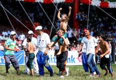 A young wrestler celebrates after winning his division at the Kirkpinar Turkish Oil Wrestling Festival in Edirne in Turkey. Stock Image