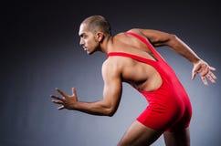 Young wrestler in dark studio Royalty Free Stock Image