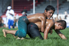 Young wrestlers battle for victory at the Elmali Turkish Oil Wrestling Festival in Turkey. Elmali is a town located in the Taurus Mountains in the Antalya Royalty Free Stock Photos