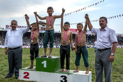Young wrestlers stand on the winners dais at the Elmali Turkish Oil Wrestling Festival, Turkey. Stock Images