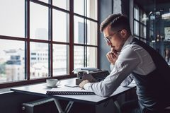 Young writer at work. In the office royalty free stock photo