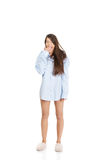 Young yawning woman in big shirt. Stock Photography
