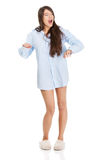 Young yawning woman in big shirt. Royalty Free Stock Image