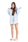 Young yawning woman in big shirt. Royalty Free Stock Images