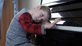 Young 5 Year Old Girl Bored Study Playing the Piano