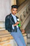 Boy with white rose. Royalty Free Stock Photos