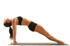 Young yoga female doing yogatic exercise. On isolated white background stock image