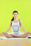 Young yoga female doing yogatic exericise. On flor Royalty Free Stock Photo