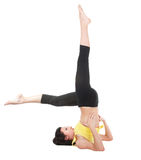 Young yoga female doing yogatic exericise Stock Photos