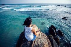 Yoga woman meditation on seaside rock royalty free stock photography
