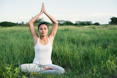 Young yoga woman sit meditation in the meadows. Royalty Free Stock Photos