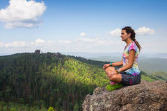 Young yoga woman sit meditation on mountain  peak Royalty Free Stock Photo