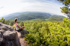 Young yoga woman sit meditation on mountain  peak Stock Photos