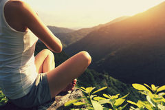 Young yoga woman sit on meditation mountain peak. Young yoga woman sit meditation on sunrise mountain peak Royalty Free Stock Images