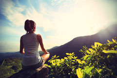 Young yoga woman at sunrise Stock Photography