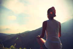 Young yoga woman at sunrise Royalty Free Stock Images