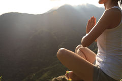 Young yoga woman at sunrise mountain Stock Photo