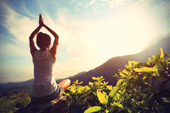 Young yoga woman at sunrise mountain Stock Image