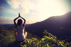 Young yoga woman at sunrise mountain Royalty Free Stock Photography