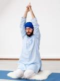 Young yogi  man doing extension Stock Photos