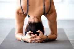 Young yogi sporty woman practicing yoga, doing salamba sirsasana stock image