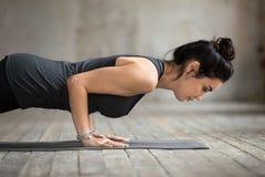 Young Yogi Woman Doing Push Ups Or Press Ups Stock Image
