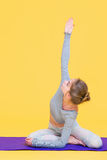 Young yogini woman stretching Stock Images