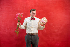Young young funny man with flowers and gift Stock Photo