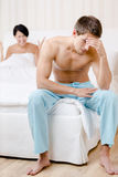 Young young married couple quarrels in bed Royalty Free Stock Photo