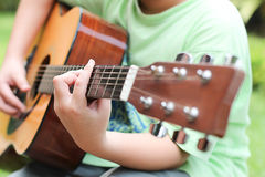 Young young Playing Guitar Royalty Free Stock Image