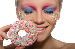 Young young woman with donut in mouth Stock Photography
