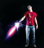 Young Zombie Man Holding Glowing Futuristic Sword. Full Length of Young Zombie Man, Wearing Torn Red Shirt and Faded Jeans, Holding Glowing Futuristic Sword Royalty Free Stock Images