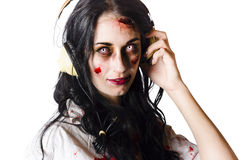 Zombie woman wearing headphones Stock Photo