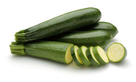 Young Zucchini. Young sliced zucchini on white background stock photography