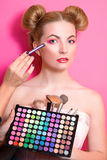 Younge attractive blonde woman with colorful make up Stock Images