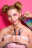 Younge attractive blonde woman with colorful make up Royalty Free Stock Images