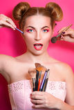 Younge attractive blonde woman with colorful make up Stock Image