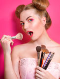 Younge attractive blonde woman with colorful make up Stock Photo