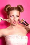 Younge attractive blonde woman with colorful make up Stock Photos