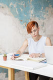 Younge woman in grunge office Stock Photography