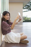 Younger asian woman self portrait by smart phone Royalty Free Stock Photo