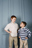 Younger boy staring up at older boy Royalty Free Stock Photo