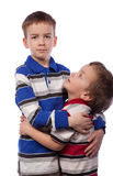 Younger brother looks at his big brother. Isolation Royalty Free Stock Photos