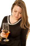Younger female model holding wine glass looking down Stock Photos