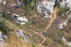 Younger Hiking Vietnam& x27;s trail in Autumn stock photography